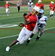 Purcell Marian's Da'Montay Everett (1) takes a pass and turns the corner on the sidlelines for a Cavaliers first down, August 22, 2018.