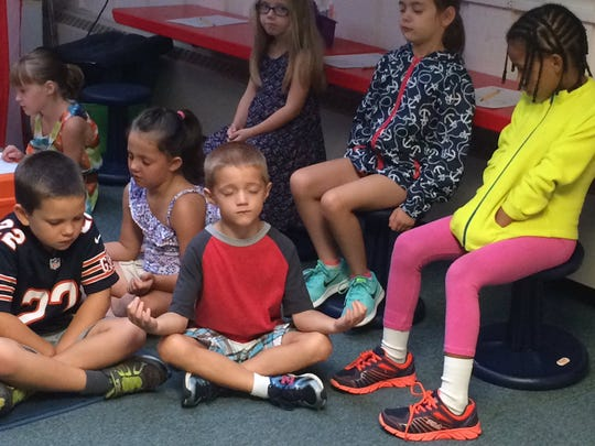 Elementary school students in the Forest Hills School District during a Mindful Music Moments session.