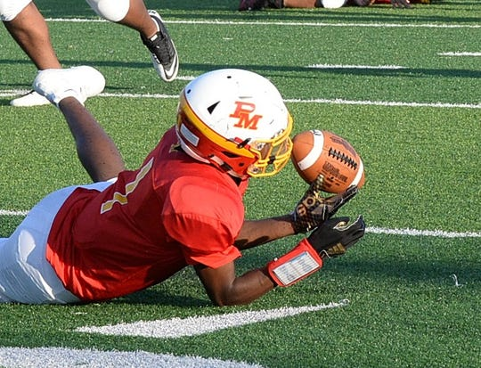 Da'Montay Everett struggles to maintain a catch on a Purcell Marian drive in the 2nd quarter, August 22, 2018.