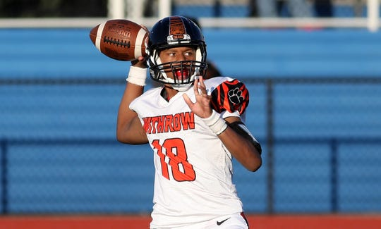Withrow quarterback Khalil Hasan throws a pass during the Tigers football game against Woodward, Wednesday, Aug. 22,2018.