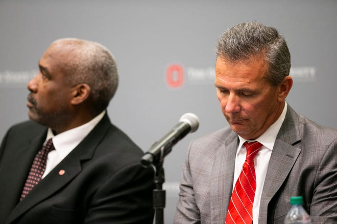 Aug 22, 2018; Columbus, OH, USA; Ohio State Buckeyes head coach Urban Meyer (right) listens as university president Michael Drake speaks at Longaberger Alumni House on the Ohio State University campus.