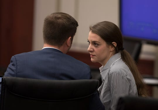 Shayna Hubers, 27, talks with Zachary Walden, one of her attorneys, in the Campbell County Courtroom of Judge Daniel Zalla on Thursday, Aug. 23, 2018, for her retrial in the shooting death of Ryan Posten, 29. Ryan was shot on October 12, 2012 in his apartment in Highland Heights.