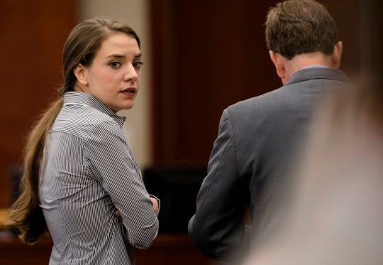 Shayna Hubers, 27, looks over at the gallery during a recess in the Campbell County Courtroom of Judge Daniel Zalla on Thursday, Aug. 23, 2018, for her retrial in the shooting death of Ryan Posten, 29. Ryan was shot on October 12, 2012 in his apartment in Highland Heights.