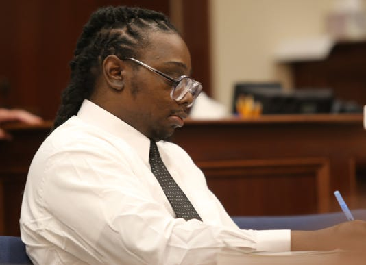 Emmanuel Wallace at the defense table