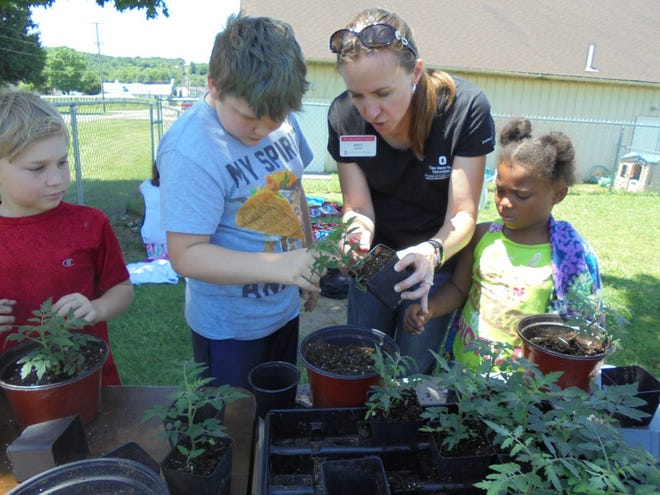Emily Buxton Adams works with youth at Kids Campus. Adams is transitioning from being the agricultural and natural resources educator for the county to the family consumer and sciences educator.