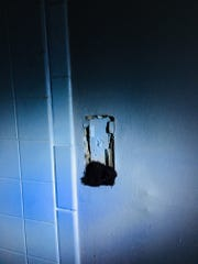 Thick mold grows out of a bathroom light fixture in Timothy Evans' former unit at Summerplace. The unit remained without electricity this week.