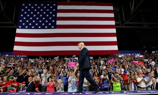 President Donald Trump arrives to speak at a rally Tuesday, Aug. 21, 2018, in Charleston, W.Va.