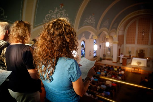 Community members gather for a prayer service in honor of Mollie Tibbetts at St. Patrick Church in Brooklyn Iowa Aug. 22, 2018.