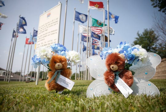 Stuffed animals with angel wings and flowers memorialize Mollie Tibbetts in Brooklyn on Thursday, Aug. 23, 2018. On Tuesday, law enforcement agents discovered remains they believe to belong to Tibbetts.
