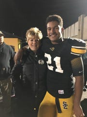 Gavin Williams poses with his mother, Kori Williams, after a Southeast Polk football game.
