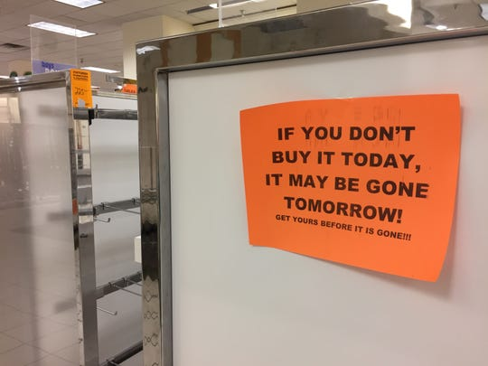 """""""If you don't buy it today, it may be gone tomorrow,"""" reads a sign on a display at the Younkers' store at Merle Hay Mall in Des Moines last week. The store closes for good Wednesday."""