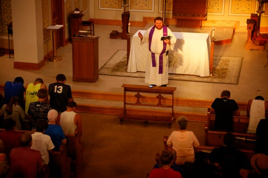 Father Corey Close leads a prayer service in honor of Mollie Tibbetts at St. Patrick Church in Brooklyn Iowa Aug. 22, 2018.
