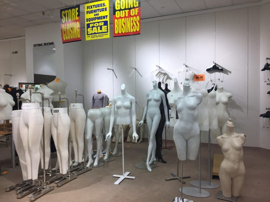Everything, including the mannequins, are on sale at the Younkers' store at Merle Hay Mall in Des Moines. The store closes for good Wednesday.
