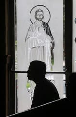 A parishioner watches a video message delivered by Bishop of Scranton Joseph Bambera during the morning Mass at Our Lady of the Eucharist in Pittston, Pa., on Sunday, Aug, 20 2018. Bambera addressed the current charges of child abuse by clergy members in the Scranton Diocese and across the state.