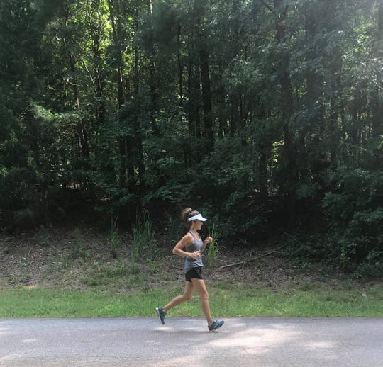 Natasha Wycheslavzoff Dekle, 46, of Athens, Georgia, goes on a run in dedication of #MilesforMollie.