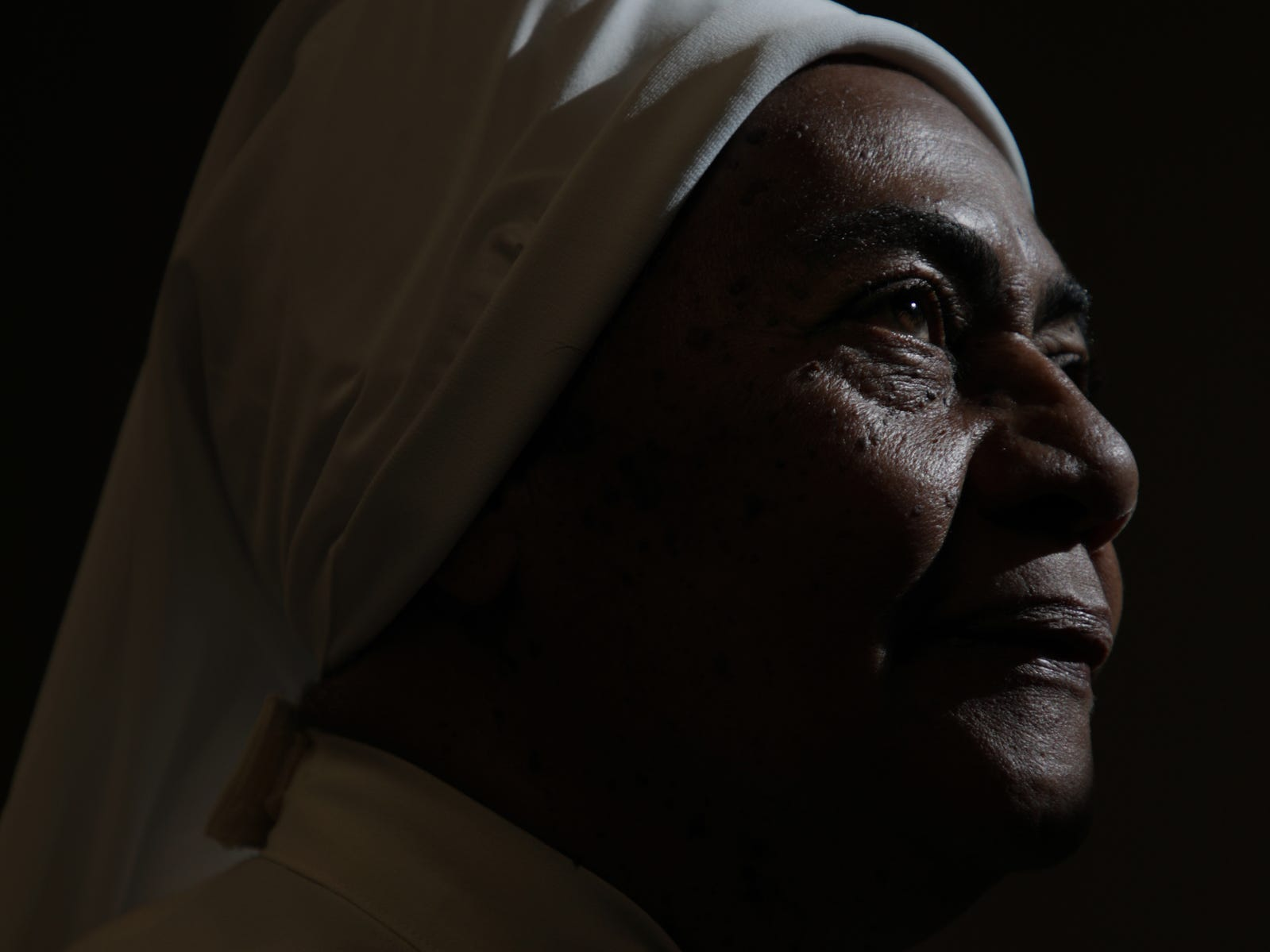 """""""The winds of Maria have gone. The direct hits are past. But the hurricane is still inside people, inside of families,"""" says sister Virgenmina Morell, 75 who is dedicated to helping others."""