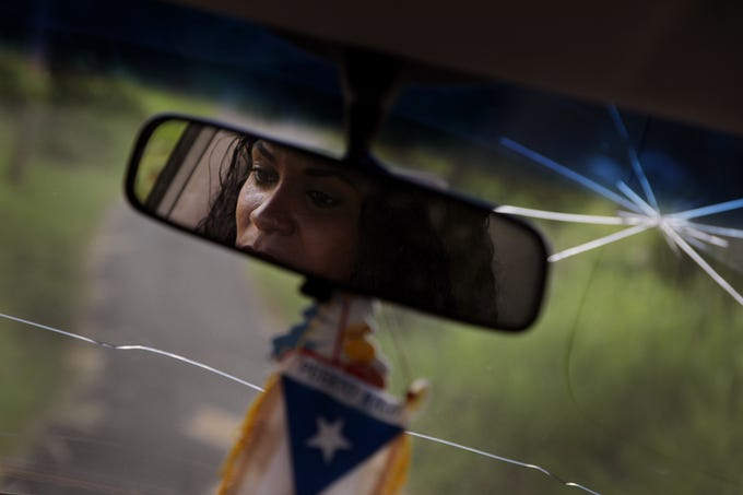 Taina Castro Cruz, 38, a former receptionist and mother of four children drives to  her way to visit residents in Humacao, Puerto Rico. Cruz has been assisting the Salvation Army.