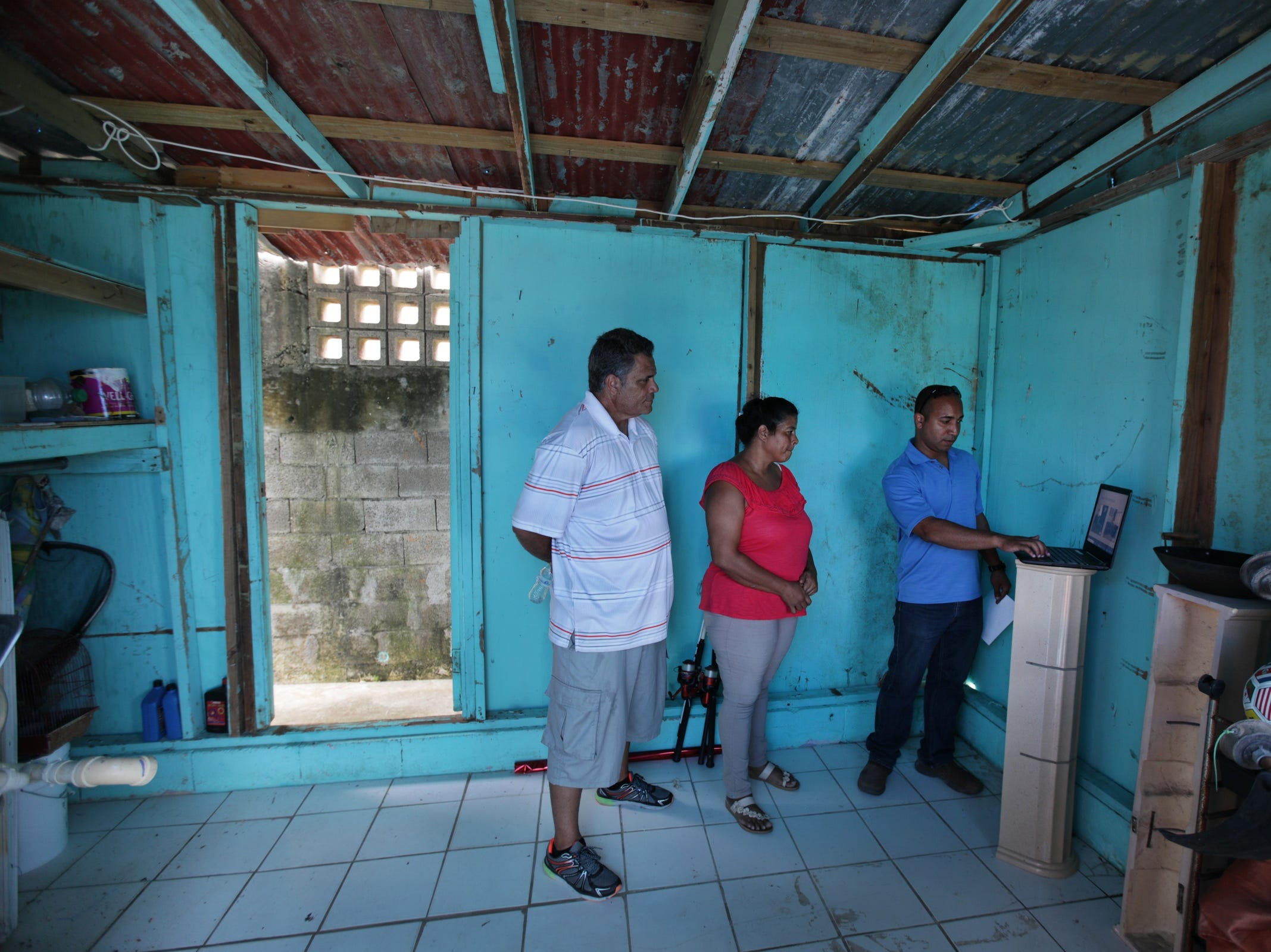 (l to r) Eleobadis Delgado and his wife Luz Delgado  stand in the shelter they have built where their home once stood, choosing new dinning room, bedroom and living room sets with the help of Ebel Rodriguez of the Salvation Army in Maunabo, Puerto Rico. The furniture will be donated by the Salvation Army with support from the Ford Fund to help the Delgados rebuild their lives since their home was leveled by Hurricane Maria ten months prior.