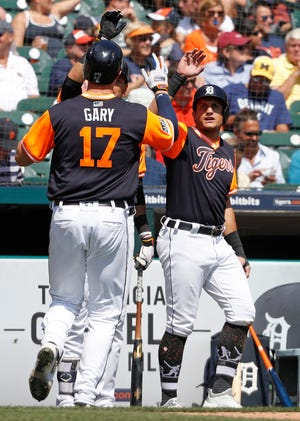 Tigers left fielder Mikie Mahtook, right, celebrates with catcher Grayson Greiner (17) during the fourth inning on Thursday, Aug. 23, 2018, at Comerica Park.
