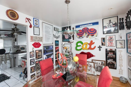 Dinning room in the in the home owned by Shanise Tucker in Allen Park on Wednesday, August 22, 2018. The home will be on the Weird Homes Tour on Saturday, August 25, 2018