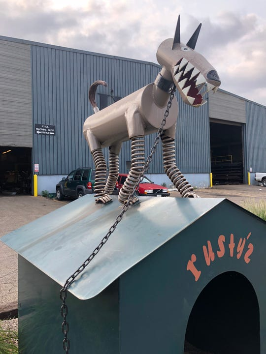 Rusty and his dog house sit outside the Padnos recycling yard in Holland. Stuart Padnos, who died in 2012, was an executive at the family's recycling business and took pride in creating art out of scrap metal.