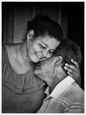 Luz Delgado and her husband Eleobadis Delgado share a tender moment after talking about the hardships they have been going through since hurricane Maria leveled their home in Maunabo, Puerto Rico on Wednesday, July 25, 2018.