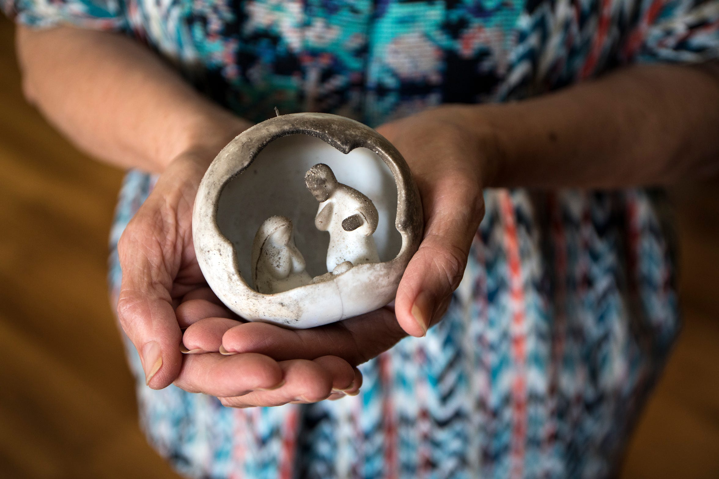 Barbara Thomas, 68 holds a small nativity ornament found in the ashes of her burned shed following the Carr fire in Keswick, Calif., Tuesday, August 21, 2018.  Her home is one of two that remain in her entire neighborhood.