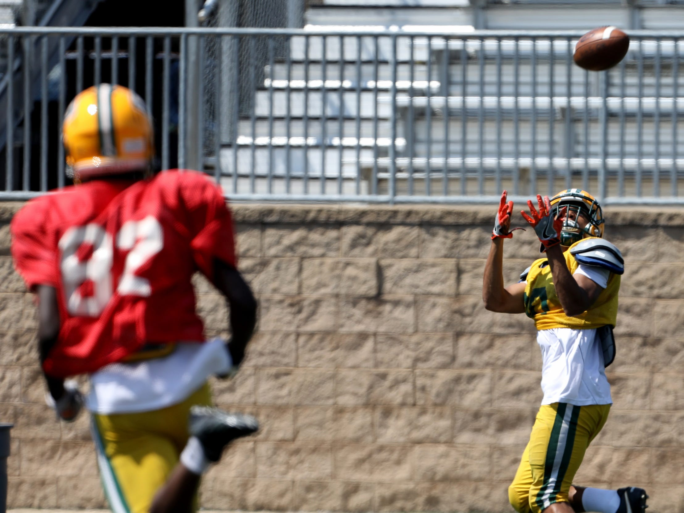 Ben Williams is wide open for the catch during Farmington Hills Harrison High School football practice at the school in Farmington Hills, Michigan on Thursday, August 23, 2018.