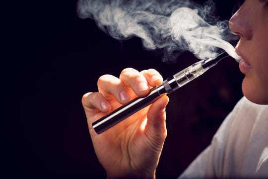 Close up of inhaling from an electronic cigarette.