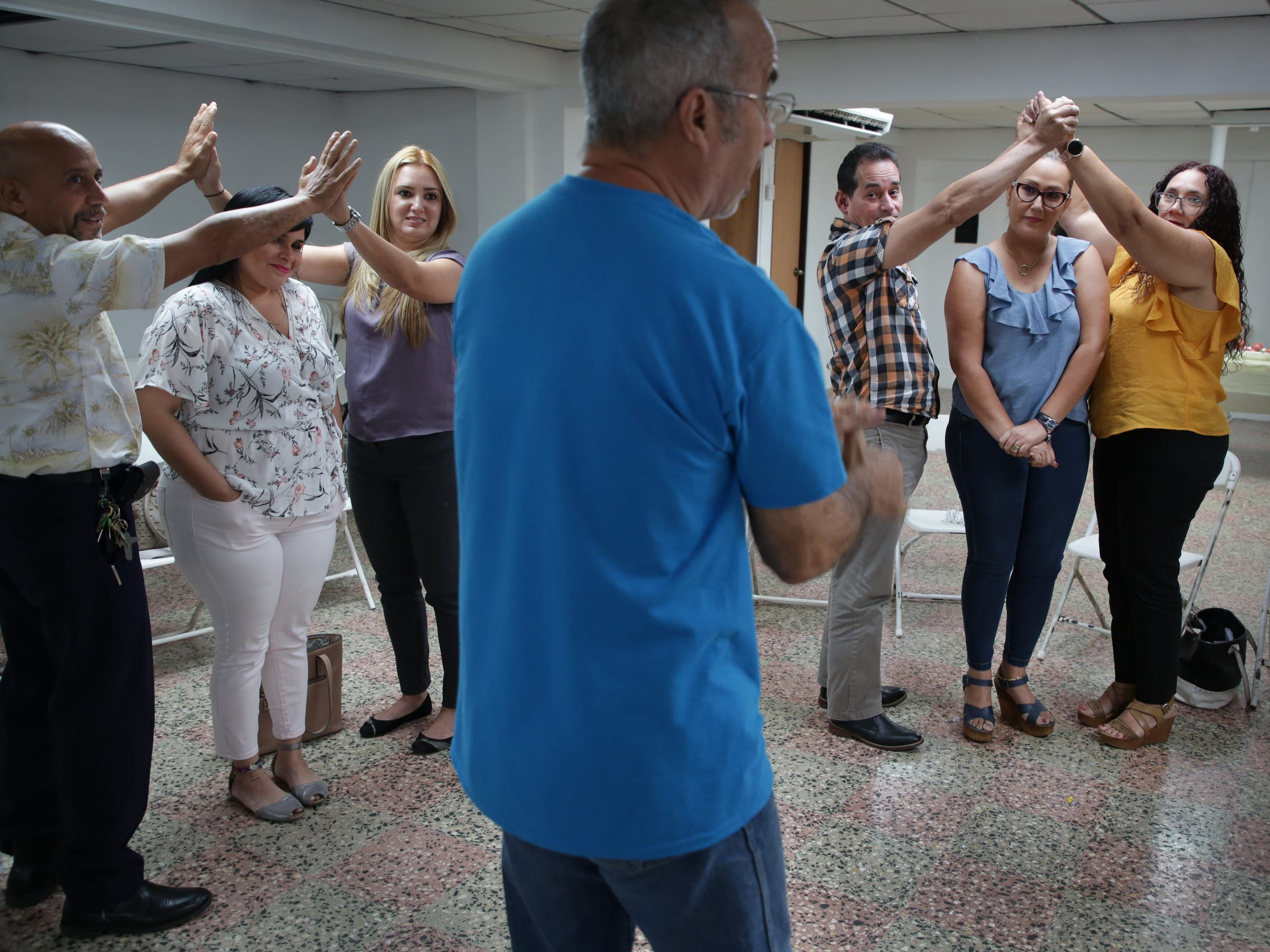 """People participate in a workshop called """"Managing your emotions after Maria"""" in Utuado, Puerto Rico. The workshop is sponsored by the Ford Fund and helps people learn how to deal with their  feelings and emotions in relation to the trauma experienced in the aftermath of hurricane Maria."""