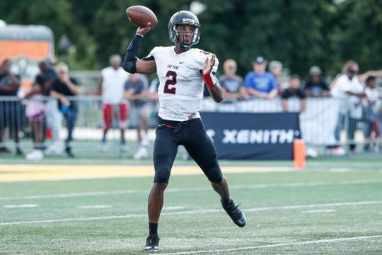 Oak Park quarterback Dwan Mathis (2) makes a pass against Utica Eisenhower during the first half of a Prep Kickoff Classic game at Wayne State University's Tom Adams Field in Detroit, Thursday, August 23, 2018.