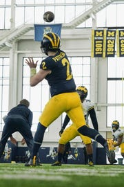 Shea Patterson throws a pass in practice.