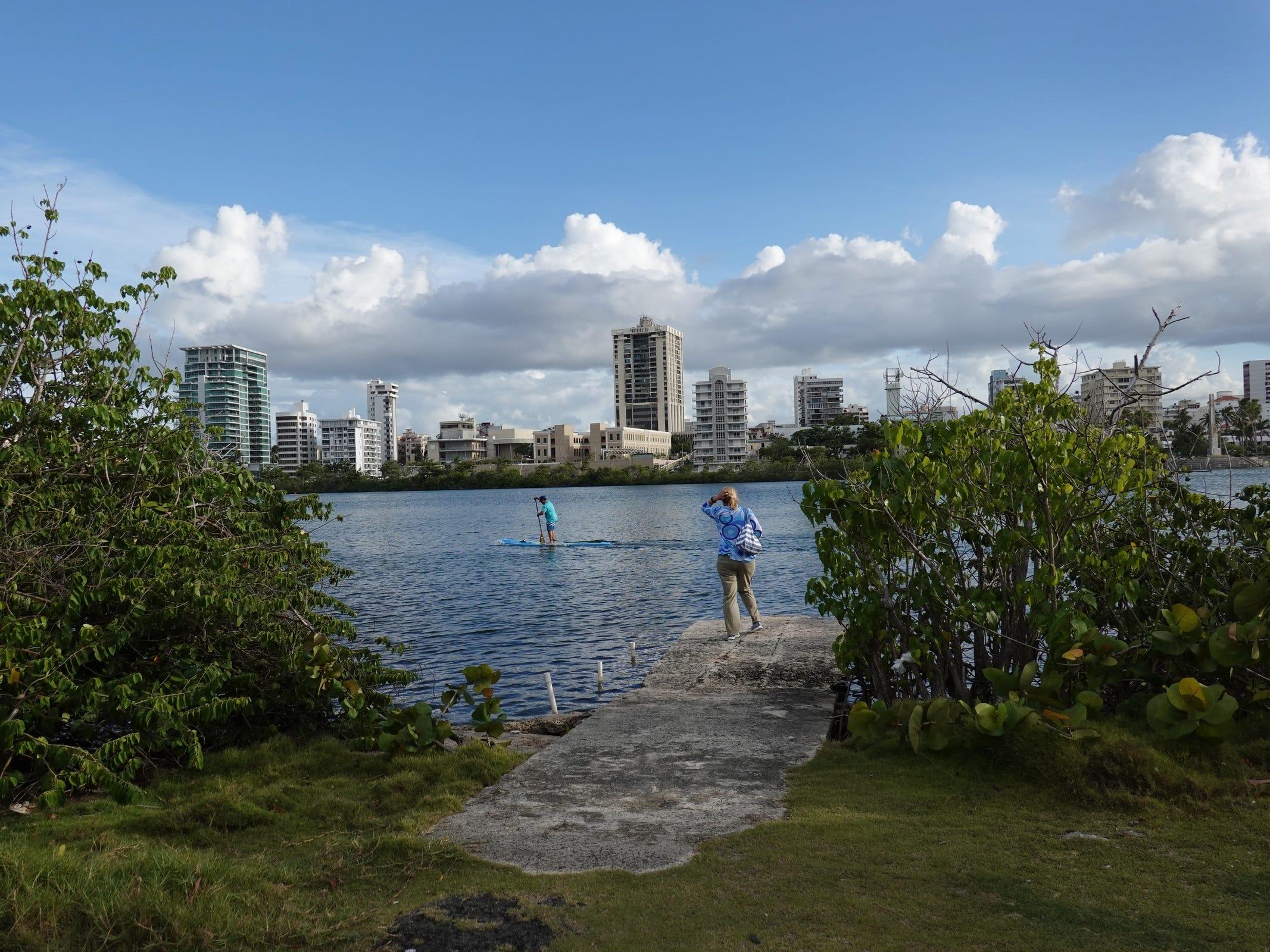 A paddle boarder passes by on Laguna del Condado in San Juan, Puerto Rico.