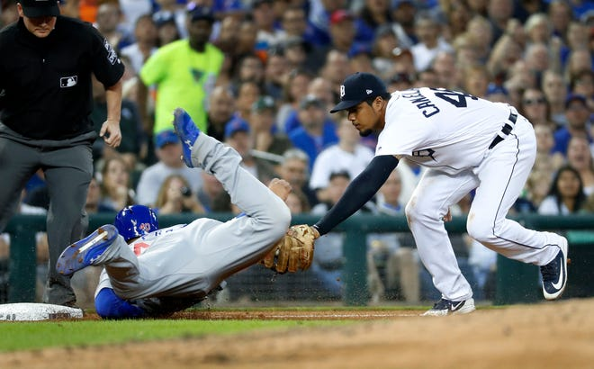 Detroit Tigers third baseman Jeimer Candelario tags out Chicago Cubs' Willson Contreras at third base during the fifth inning in Detroit, Wednesday, Aug. 22, 2018.