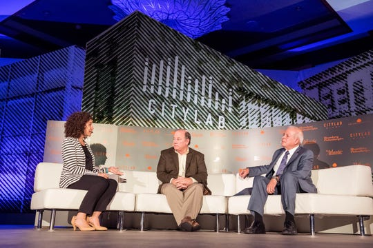 From left, moderator Janis Bowdler, head of Community Development for Global Philanthropy, JPMorgan Chase & Co., Mike Duggan, mayor of Detroit and  omàs Regalado, mayor of Miami, Florida, on stage for a panel discussion on rebuilding neighborhoods during the the CityLab conference in Miami, Fla. In 2016.