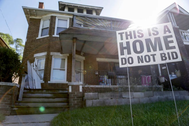 In Wayne County, 451 occupied homes are headed to the annual tax foreclosure auction in 2018. Some residents, like the occupants of this home – marked for auction in 2017 – post signs pleading with prospective buyers not to bid.