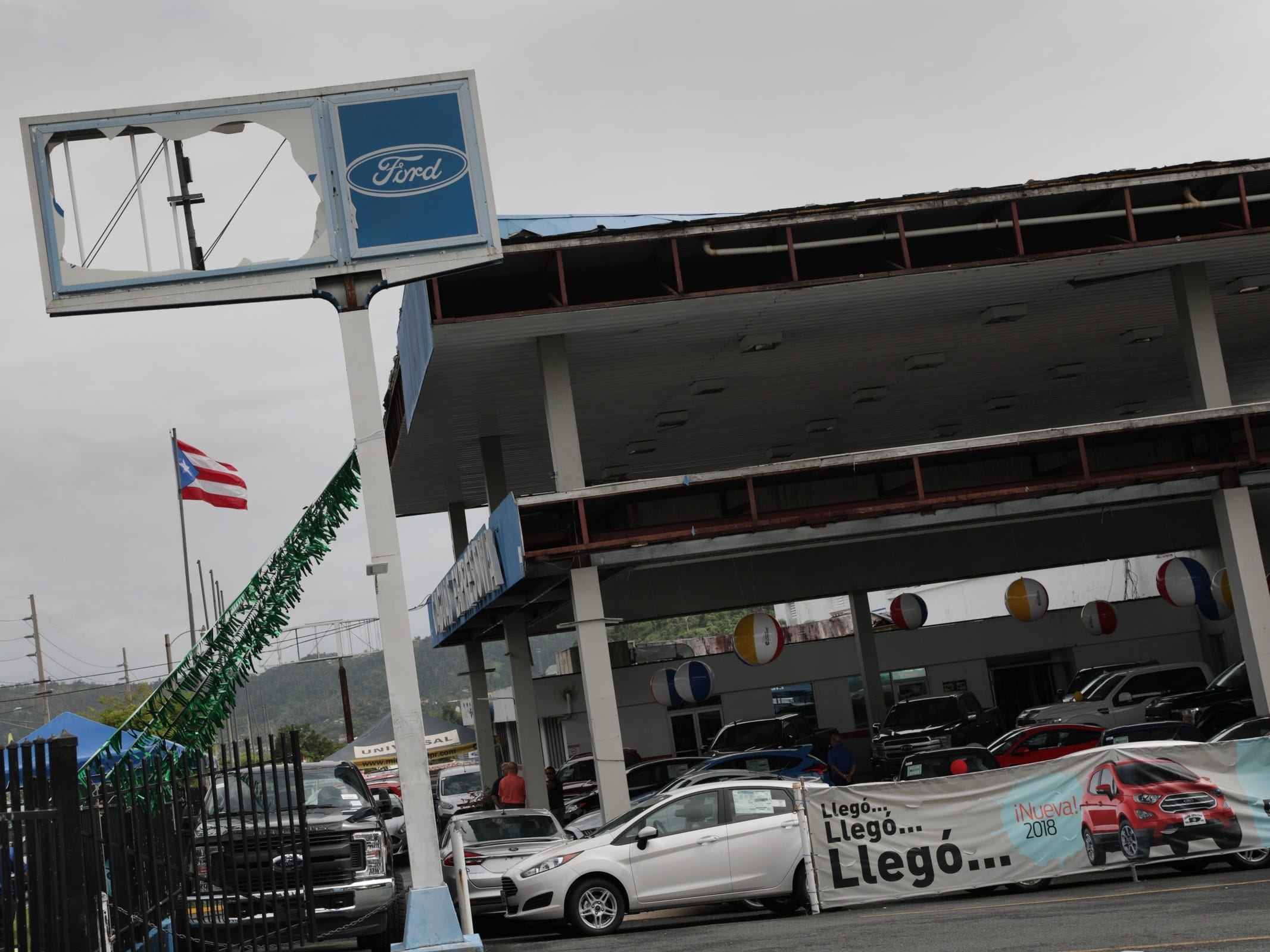 Damage to the Caguas Expressway Motors sign, a Ford dealer is still visible ten months after Hurricane Maria hit Caguas, Puerto Rico.