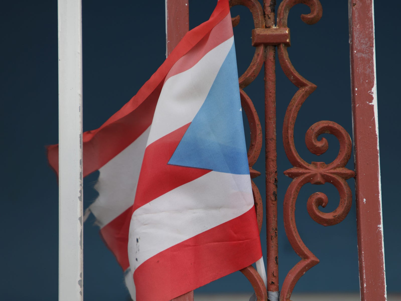 A Puerto Rican flag hangs at the entrance of the Rodriguez home in Yabucoa, Puerto Rico.