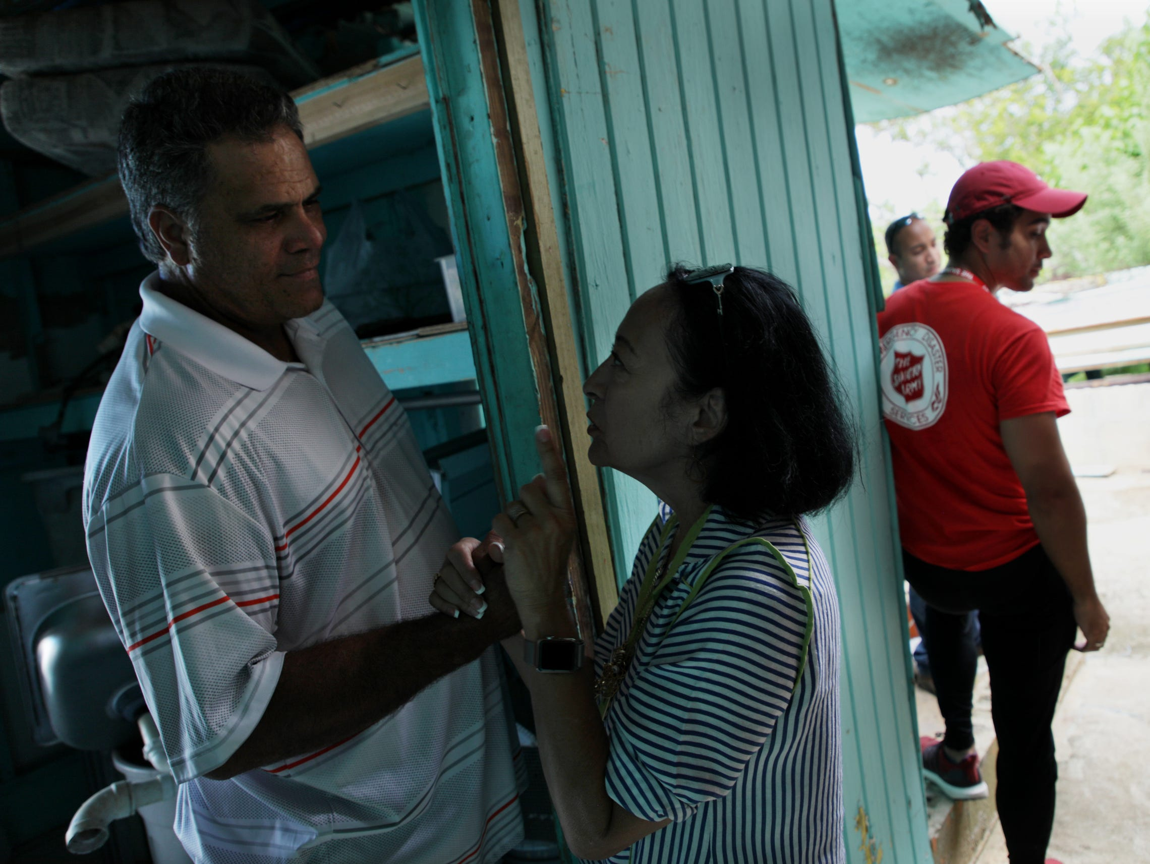 Eleobadis Delgado, left says good bye to Gloria Rodriguez after a visit by the Ford Fund and the Salvation Army at his home in Maunabo, Puerto Rico.