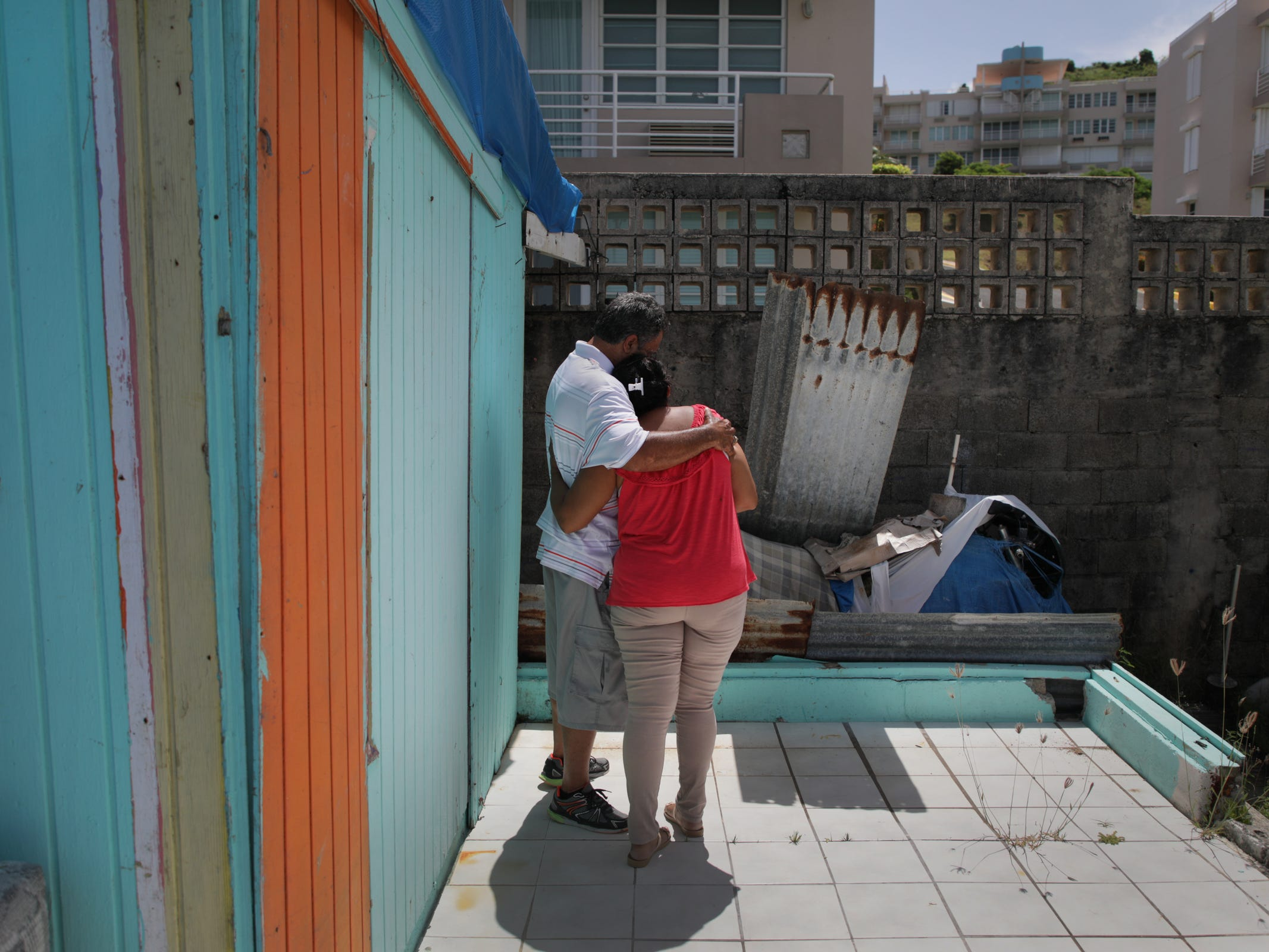 Luz Delgado comforts her husband Eleobadis Delgado after he became emotional while talking about the hardships he and fellow Puerto Ricans are experiencing physically and emotionally since Hurricane Maria devastated the island ten months prior.