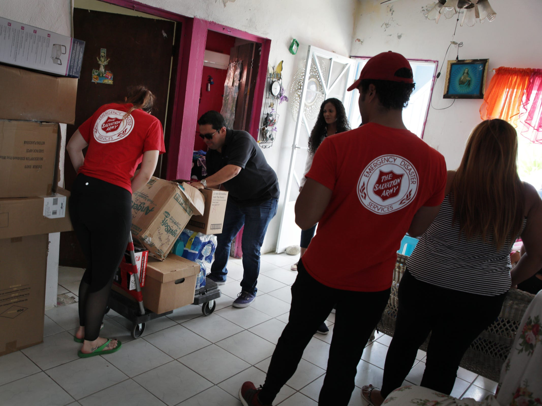 The Salvation Army who gets support from the Ford Fund delivers supplies to several members of a family who had to move in together with their children after their homes were damaged by Hurricane Maria in Yabucoa, Puerto Rico.