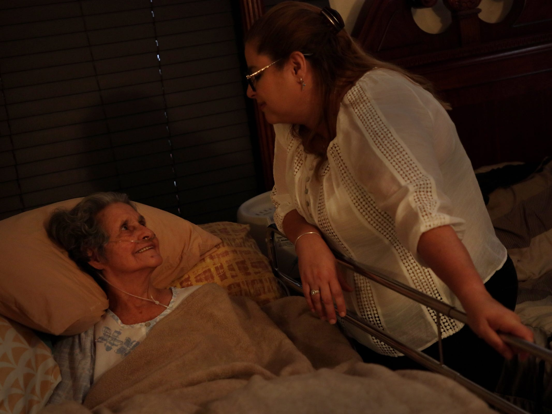 Luisa Carmona Collazo, right tends to her mother Rosario Collazo Mejias who suffers from Alzheimers disease at her home in Bayamon, Puerto Rico on Saturday, July 28, 2018.