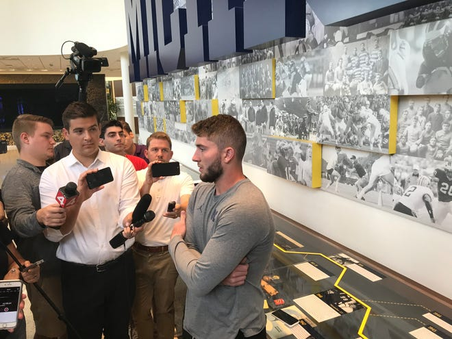 Michigan quarterback Shea Patterson speaks with reporters in Ann Arbor on Aug. 23, 2018.