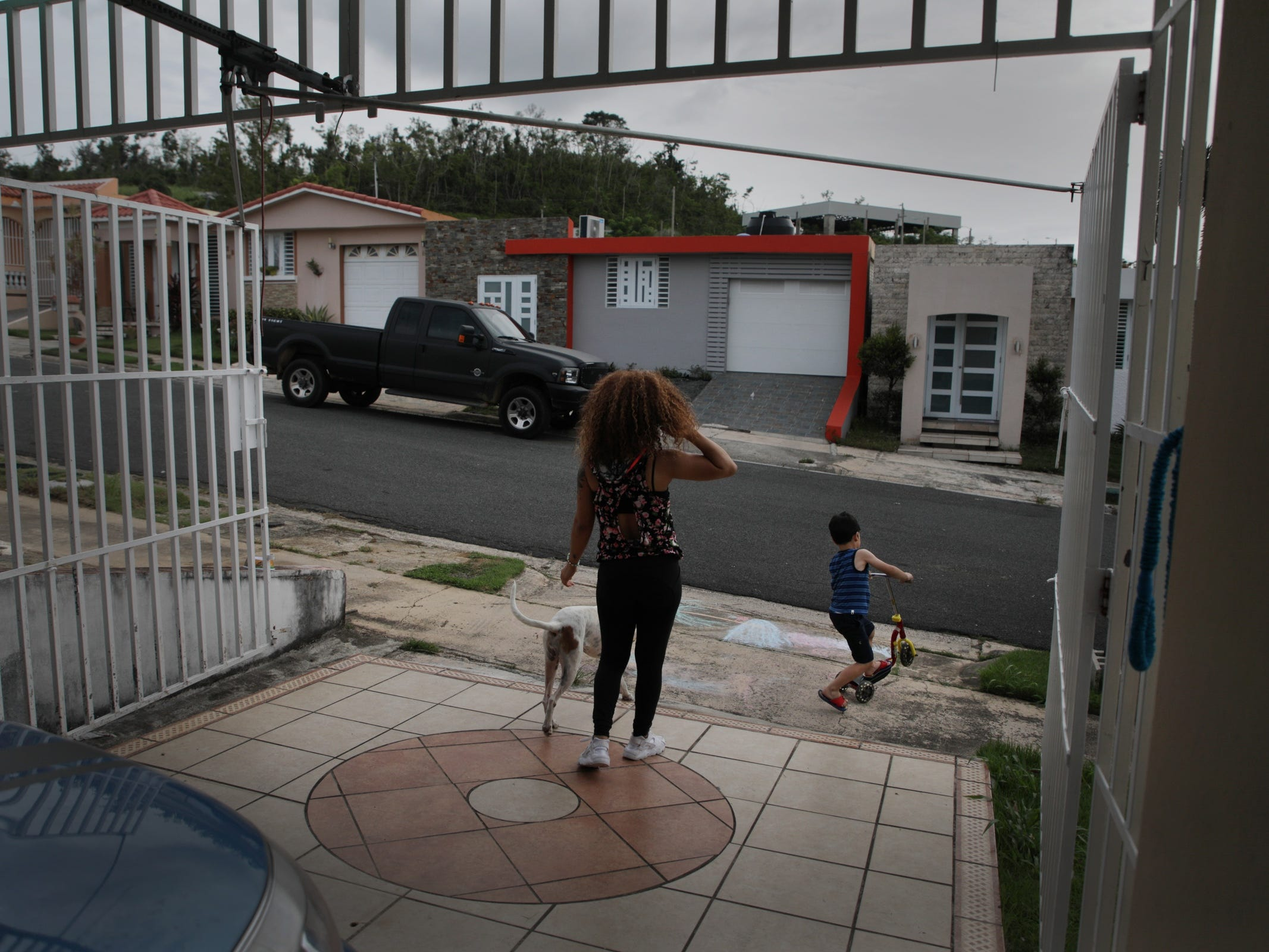 Ashlie Camilo Sosa, 20 and her 5 year old son Jonathan Diaz play outside their home in Toa Alta. Sosa and her son benefited from strong support from Proyecto Nacer, a support network for young parents supported in part by the Ford Fund.