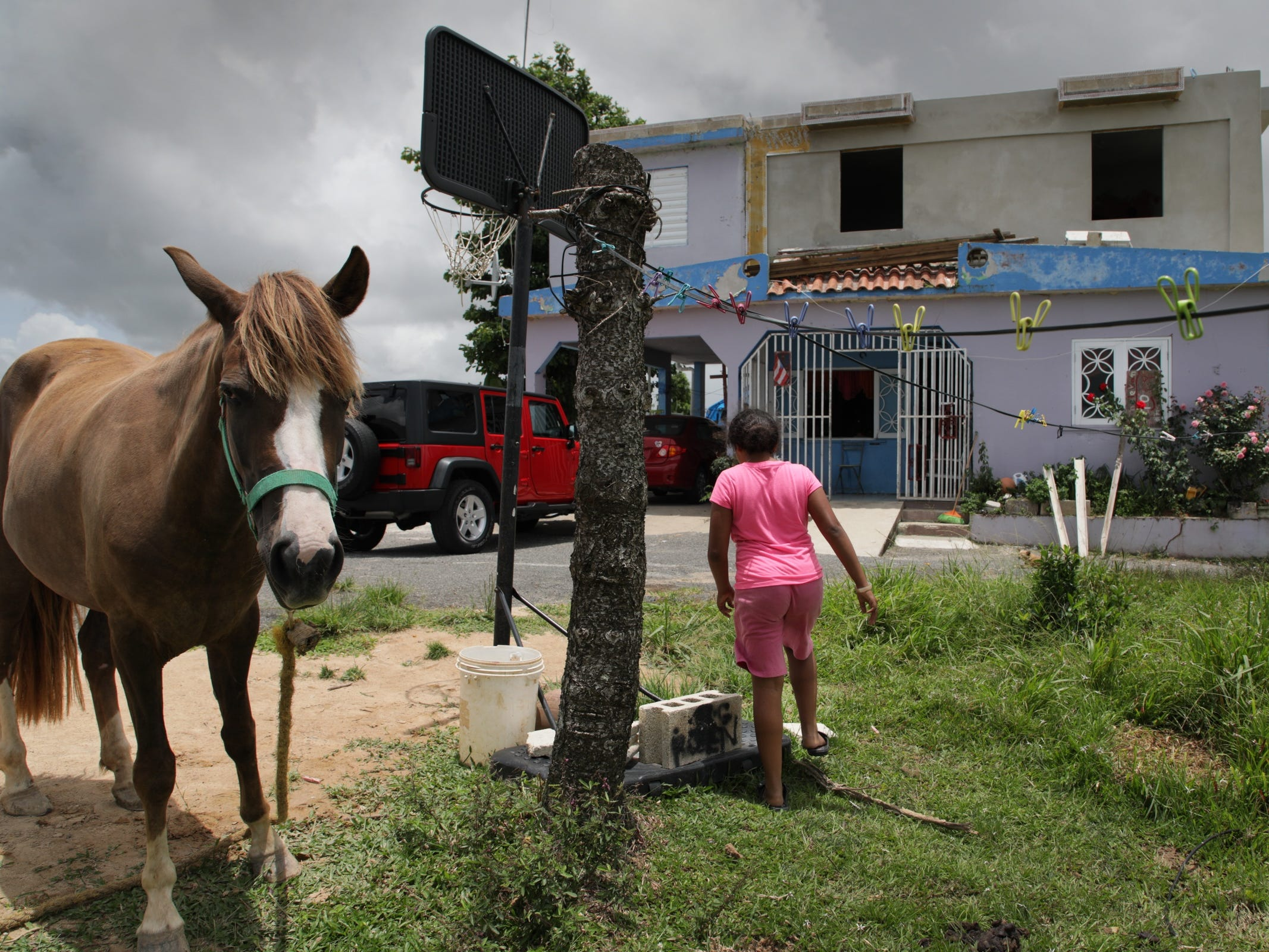 Nayeli Aponte 12 walks back to the house she shares with eight other family members since Hurricane Maria devastated the country.