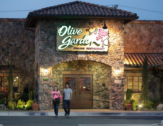 Patrons exit an Olive Garden restaurant in Short Pump, Virginia.