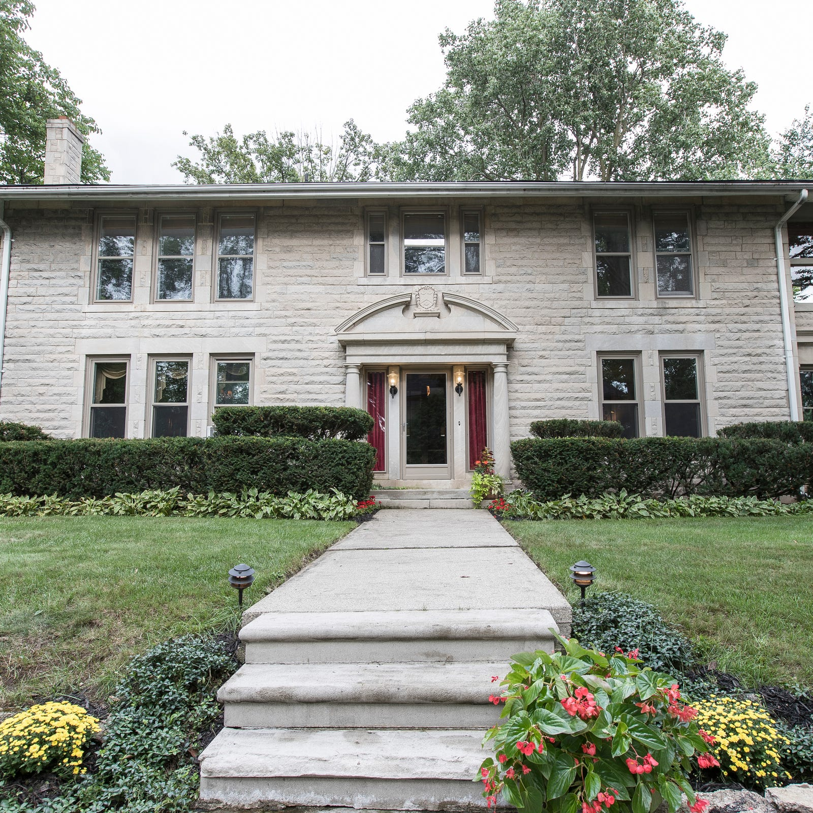 Surrounded by wannabes, this vintage limestone house in Royal Oak shines