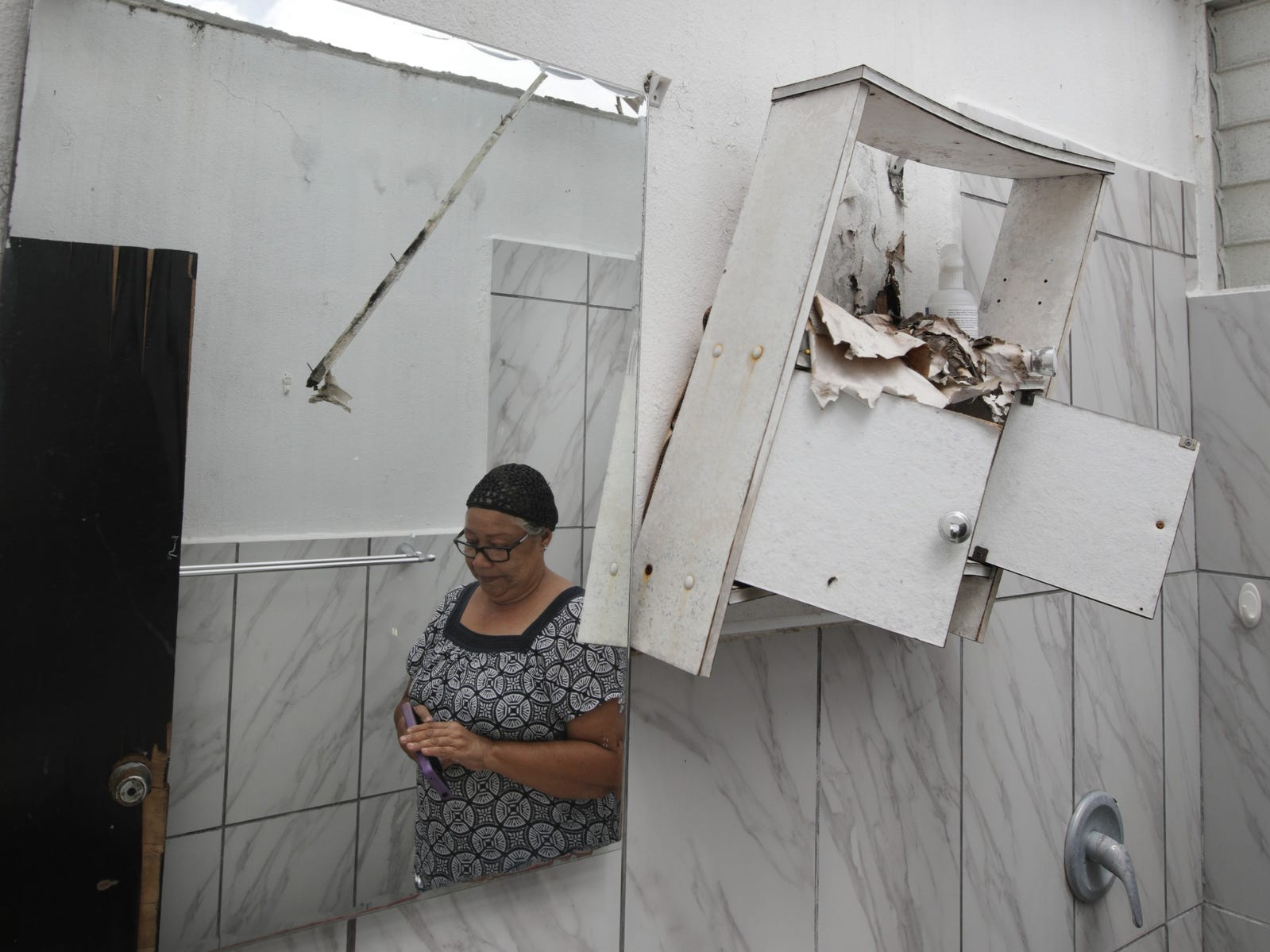 Only the walls of Carmen Rivera's bathroom stand after her home was devastated by Hurricane Maria in Humacao, Puerto Rico.