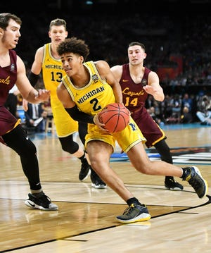 Michigan guard Jordan Poole (2), shown here driving against Loyola in the 2018 NCAA Tournament, led the Wolverines with 16 points in Thursday's exhibition loss to KK Mega Bemax.