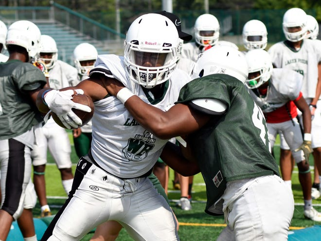 Running back Donovan Edwards, left, and West Bloomfield will take on Birmingham Groves in Week 1.